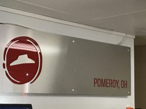 Part of the new interior design of the Pomeroy Pizza Hut hangs behind the counter. Photo by Carrie Gloeckner.